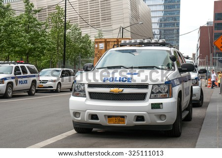 NEW YORK - MAY 12, 2015: NYPD Police car in Manhattan. The New York City Police Department, established in 1845, is the largest municipal police force in the United States.  - stock photo