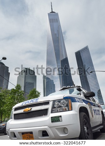 NEW YORK - MAY 12, 2015: NYPD Police car in Manhattan with Freedom Tower. The New York City Police Department, established in 1845, is the largest municipal police force in the United States.  - stock photo