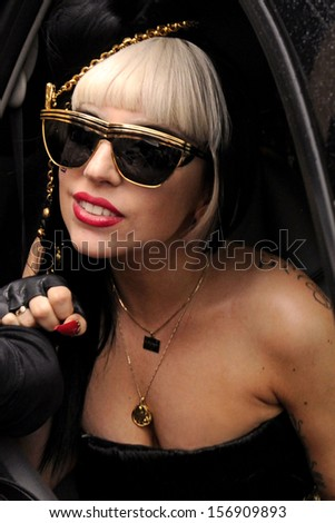 "NEW YORK - MAY 23:  Pop superstar Lady Gaga greets her ""Little Monster"" fans while leaving the View television show outside ABC Studios on May 23, 2011 in New York City. - stock photo"