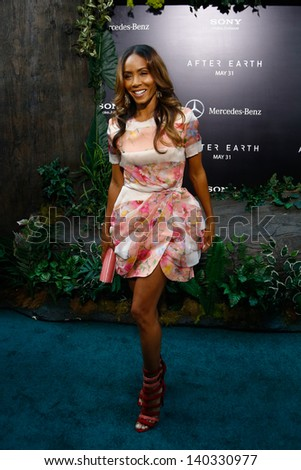 """NEW YORK - MAY 29: Producer Jada Pinkett Smith attends the premiere of """"After Earth"""" at the Ziegfeld Theatre on May 29, 2013 in New York City.  - stock photo"""