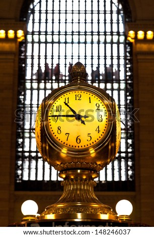 NEW YORK, May 7th, 2013. Clock over the information booth in the middle of the great hall in Grand Central Terminal - New York on May 7. Grand Central Station is the world famous spot in New York City - stock photo