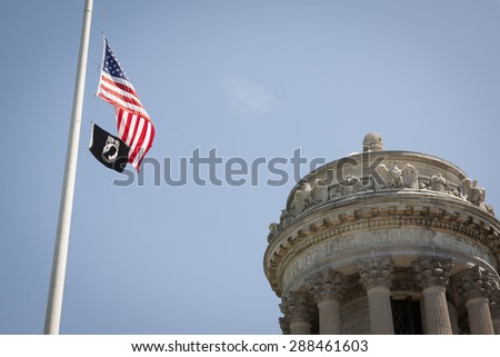 NEW YORK - MAY 25 2015: The American and POW/MIA Flags wave in front of the Soldiers and Sailors Monument in Riverside Park after the annual Memorial Day Observance service during Fleet Week NY 2015. - stock photo