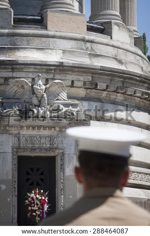 NEW YORK - MAY 25 2015: The words In Memoriam carved into the marble of the Soldiers and Sailors Monument in Manhattan with a US Marine in the foreground on Memorial Day during Fleet Week 2015. - stock photo