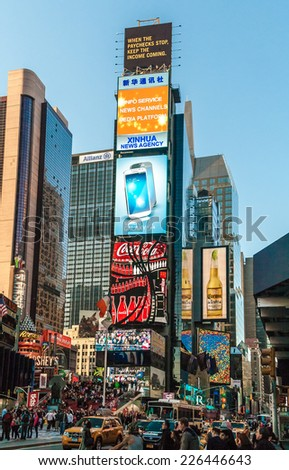 """NEW YORK - MAY 6: Times Square, New York, May 6, 2013. It's a major commercial intersection, iconified as """"The Crossroads of the World"""", it's also the hub of the Broadway Theater District.  - stock photo"""