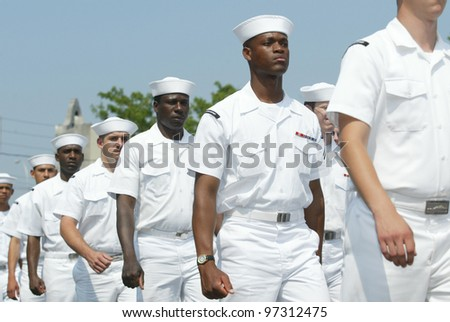 NEW YORK - MAY 29:  U.S. sailors march in the Little Neck/Douglaston Memorial Day Parade May 29, 2006 in Queens, NY. - stock photo