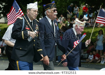 NEW YORK - MAY 29:  Veterans participate in the Little Neck/Douglaston Memorial Day Parade May 29, 2006 in Queens, NY. - stock photo