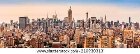 New york midtown skyline panorama at sunset. - stock photo