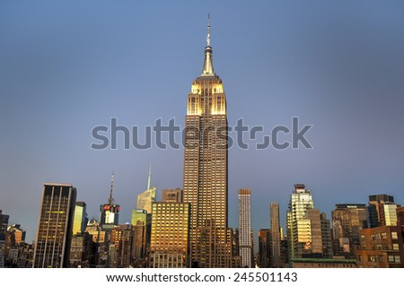 NEW YORK, NEW YORK - JANUARY 10, 2015: New York City skyline with urban skyscrapers at sunset. - stock photo