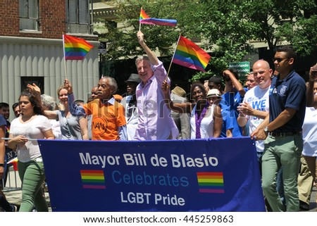 NEW YORK, NEW YORK - JULY 26, 2016: Mayor Bill de Blasio and Al Sharpton marching in Gay Pride Parade on 5th avenue. The rainbow flag is the symbol of LGBT pride and diversity. Editorial use only.  - stock photo