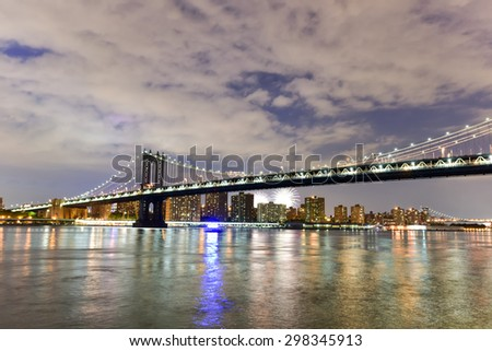 New York, New York - July 4, 2015: View of the Brooklyn Bridge and Manhattan Bridge during Independence Day fireworks from Brooklyn Bridge Park, New York. - stock photo