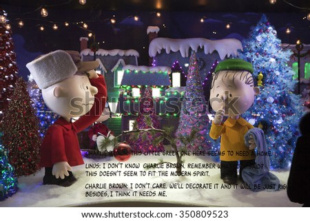 NEW YORK, NEW YORK, USA - DECEMBER 10: A Macy's window display for Christmas showing Charlie Brown and Linus picking a Christmas tree.  Taken December 10, 2015 in NY. - stock photo