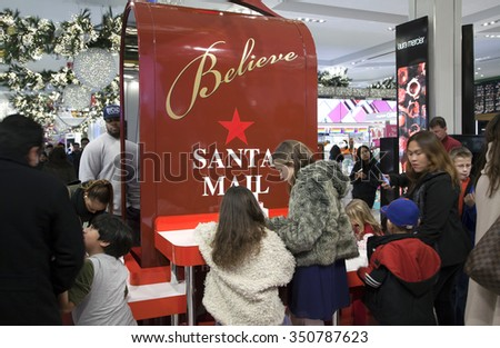 NEW YORK, NEW YORK, USA - DECEMBER 10: Children write letters to Santa inside Macy's department store in Herald Square and 34th street.  Taken December 10, 2015 in NY. - stock photo