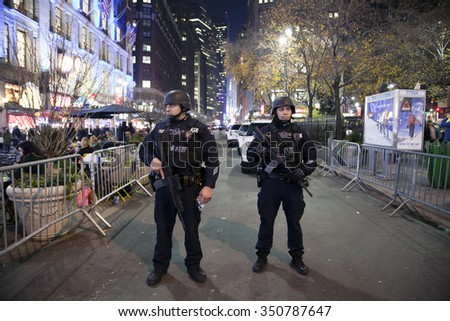 NEW YORK, NEW YORK, USA - DECEMBER 10: Members of the NYPD Police Strategic Response Group stand guard at Christmas time in Herald Square and 34th street.  Taken December 10, 2015 in NY. - stock photo