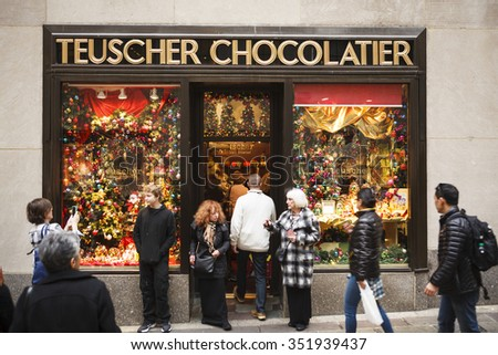 New York, New York, USA - December 11, 2015: People going in and out of Teuscher Chocolatier in Rockefeller Center in Manhattan during the Christmas Holiday season. - stock photo