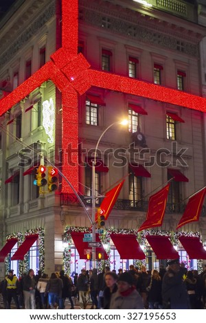 New York, New York, USA - November 28, 2012: A brilliant giant red ribbon and bow made of lights can be seen on Cartier on 5th Avenue in New York City during the 2012 Christmas Holiday season. - stock photo