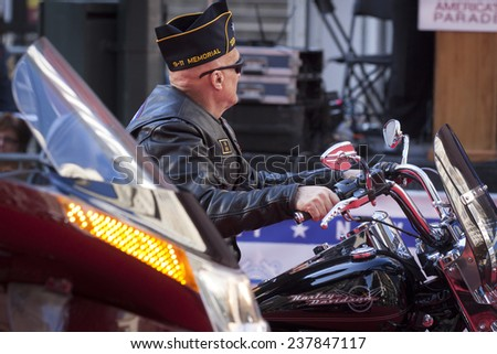 NEW YORK - NOV 11, 2014: A US vet rides a Harley Davidson in the 2014 America's Parade held on Veterans Day in New York City on November 11, 2014. - stock photo