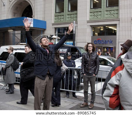 NEW YORK- NOV 17:An unidentified man becomes upset after failing to provide proper identification at police checkpoint during Occupy protests on Broadway on November 17, 2011 in New York City. - stock photo