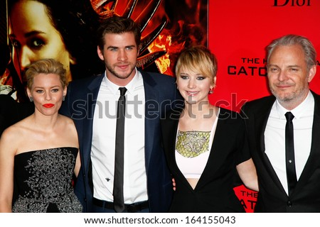 "NEW YORK-NOV 20; Elizabeth Banks, Liam Hemsworth, Jennifer Lawrence and Francis Lawrence attend ""The Hunger Games: Catching Fire"" screening at AMC Lincoln Square on November 20, 2013 in New York City. - stock photo"