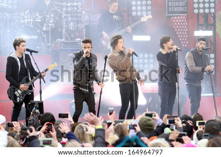 NEW YORK - NOV 26: One Direction performs on 'Good Morning America' in Central Park on November 26, 2013 in New York City. - stock photo