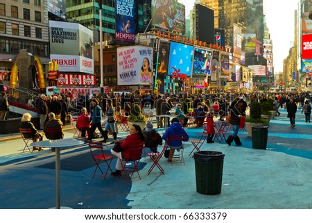 """NEW YORK - NOV 27: Time Square is thriving before Christmas and display its Christmas decorations, the famous show """"Lion King"""" is playing at the Minskoff Theater, on November 27, 2010, in New York. - stock photo"""
