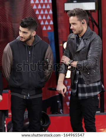 NEW YORK - NOV 26: Zayn Malik and Liam Payne of One Direction perform on 'Good Morning America' in Central Park on November 26, 2013 in New York City. - stock photo