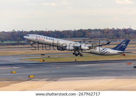 NEW YORK - NOVEMBER 3: Airbus A340 China Eastern Airlines painted in the SkyTeam livery approaches JFK Airport in New York, USA on November 3, 2013. China Eastern Airlines is a major Chinese airline. - stock photo