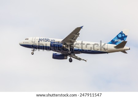 NEW YORK - NOVEMBER 3: Airbus A320 JetBlue arrives at JFK Airport in New York, NY on November3, 2013. The A320 was the first narrow body airliner from Airbus.  - stock photo