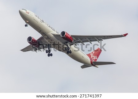NEW YORK - NOVEMBER 3: Airbus 330 Virgin Atlantic approaches JFK in New York, NY on November 3, 2013. Virgin Atlantic is British airline owned by Richard Branson's Virgin Group and Singapore Airlines. - stock photo