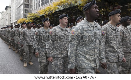 NEW YORK - NOVEMBER 11: Atmosphere during the 94th annual New York City Veterans Day Parade on 5th Avenue on November 11, 2013 in New York City - stock photo