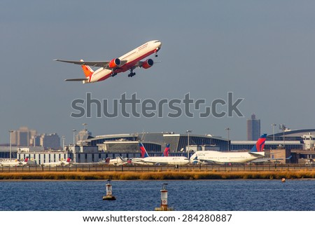 NEW YORK - NOVEMBER 3: Boeing 777 Air India takes off from JFK Airport in New York, NY on November 3, 2013. Air India is the flag carrier and the third largest airline in India. - stock photo