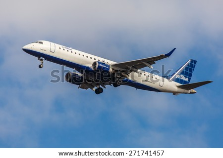 NEW YORK - NOVEMBER 3: Embraer 190 JetBlue takes off from JFK Airport in New York, NY on November 3, 2013. JetBlue is New York based, fastest growing airline in the world. - stock photo