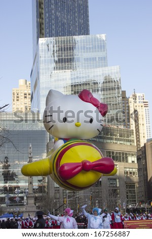 NEW YORK - NOVEMBER 28: Hello Kitty balloon flown low due to windy weather condition during the 87th Annual Macy's Thanksgiving Day Parade on November 28, 2013 in New York City.  - stock photo