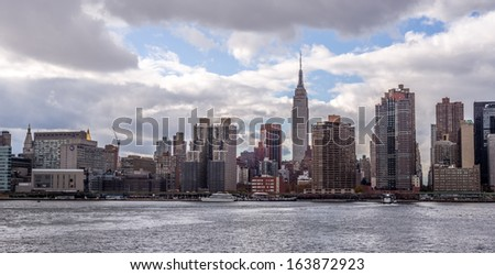 NEW YORK - NOVEMBER 8: Manhattan Skyline during the day on November 8, 2013 in New York. Manhattan is the geographically smallest yet most populous of New York City's five boroughs. - stock photo