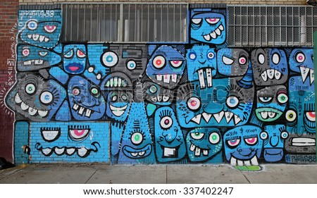 NEW YORK - NOVEMBER 8, 2015: Mural art at East Williamsburg in Brooklyn. Outdoor art gallery known as the Bushwick Collective has most diverse collection of street art in Brooklyn - stock photo