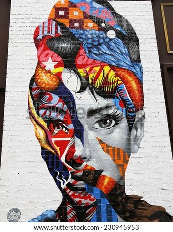 NEW YORK - NOVEMBER 16: Mural art by Tristan Eaton in Little Italy on November 16, 2014. A mural is any piece of artwork painted or applied directly on a wall, ceiling or other large permanent surface - stock photo