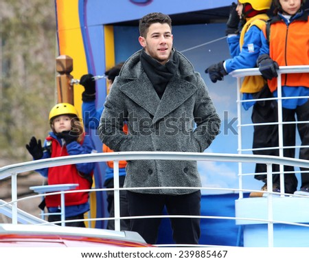 NEW YORK - NOVEMBER 27: Nick Jonas appears at the 88th Annual Macy's Thanksgiving Day Parade on November 27, 2014 in New York City. - stock photo