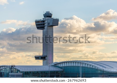 NEW YORK - NOVEMBER 3: - November 3, 2013: Air traffic control tower at JFK Airport in New York, NY on November 3, 2013. JFK Airport is New York's main international airport opened in 1948. - stock photo