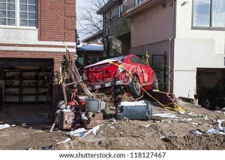 NEW YORK - NOVEMBER 8, 2012:Pile of garbage, debris, car and household items near flooded and damaged house after Hurricane Sandy  on Manhattan Beach on November 8, 2012, Brooklyn, NY - stock photo