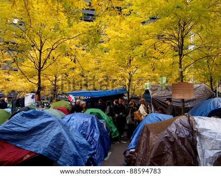 NEW YORK - NOVEMBER 11: Protestors live in a tent village during the Occupy Wall Street movement, November 11, 2011 in New York City, NY. The protest began in Zuccotti Park on September 17, 2011. - stock photo