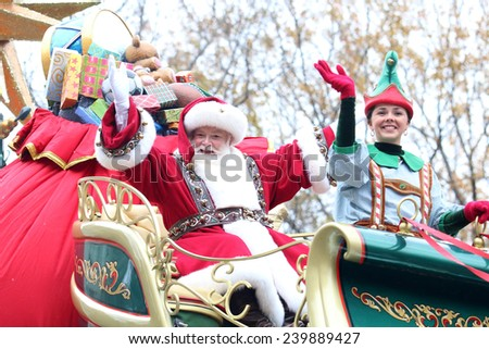 NEW YORK - NOVEMBER 27: Santa Claus appears at the 88th Annual Macy's Thanksgiving Day Parade on November 27, 2014 in New York City. - stock photo