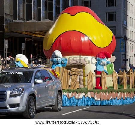 NEW YORK - NOVEMBER 22: Smurf characters ride on float at the 86th Annual Macy's Thanksgiving Day Parade on November 22, 2012 in New York City. - stock photo