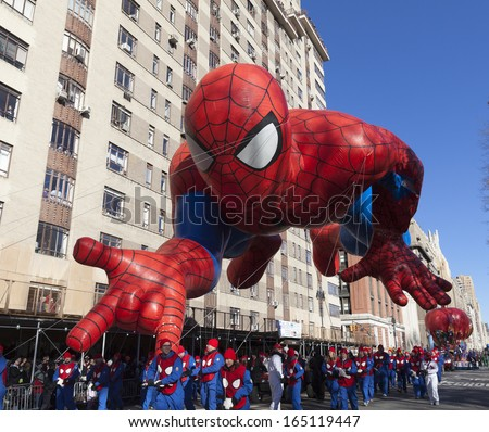 NEW YORK - NOVEMBER 28: Spiderman balloon is flown low because of weather condition at the 87th Annual Macy's Thanksgiving Day Parade on November 28, 2013 in New York City. - stock photo