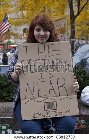 NEW YORK - NOVEMBER 14: Unidentified protester with 'Occupy Wall Street' with sign on November 14, 2011 in New York. - stock photo