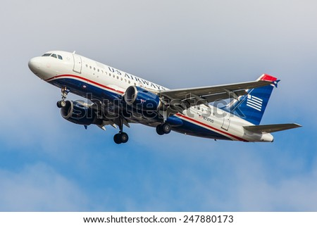NEW YORK - NOVEMBER 3: US Airways A320 arrives at JFK Airport in New York, NY on November 3, 2013. A320 was the first narrow body airliner from Airbus. It is the biggest competition to Boeing 737NG. - stock photo