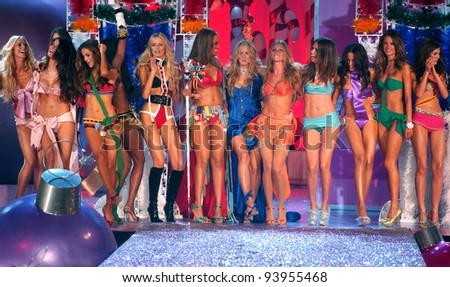NEW YORK - NOVEMBER 9: Victoria's Secret Fashion models walks the runway finale during the 2010 Victoria's Secret Fashion Show on November 9, 2005 at the Lexington Armory in New York City. - stock photo