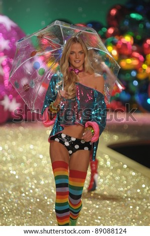 NEW YORK - NOVEMBER 10: Victoria's Secret Fashion Show model walks the runway during the 2010 Victoria's Secret Fashion Show on November 10, 2010 at the Lexington Armory in New York City. - stock photo