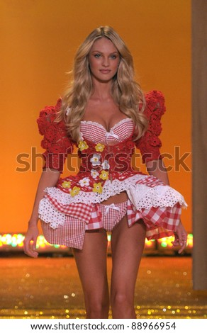 NEW YORK - NOVEMBER 10: Victoria's Secret sexy model Candice Swanepoel walks the runway during the 2010 Victoria's Secret Fashion Show on November 10, 2010 at the Lexington Armory in New York City. - stock photo
