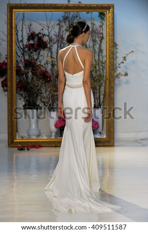 NEW YORK, NY - APRIL 14: A model walks the runway during the Anne Barge Bridal Spring/Summer 2017 Runway Show at Annex 38 on April 14, 2016 in New York City. - stock photo