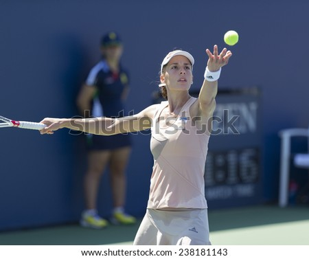 NEW YORK, NY - AUGUST 25: Andrea Petkovic of Germany returns ball during 1st round match against Ons Jabeur of Tunisia at US Open tennis tournament in Flushing Meadows USTA Tennis Center 2014 - stock photo