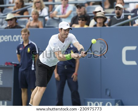 NEW YORK, NY - AUGUST 30, 2014: Andy Murray of United Kingdom returns ball during 3rd round match against Andrey Kuznetsov of Russia at US Open tennis tournament in Flushing Meadows USTA Tennis Center - stock photo